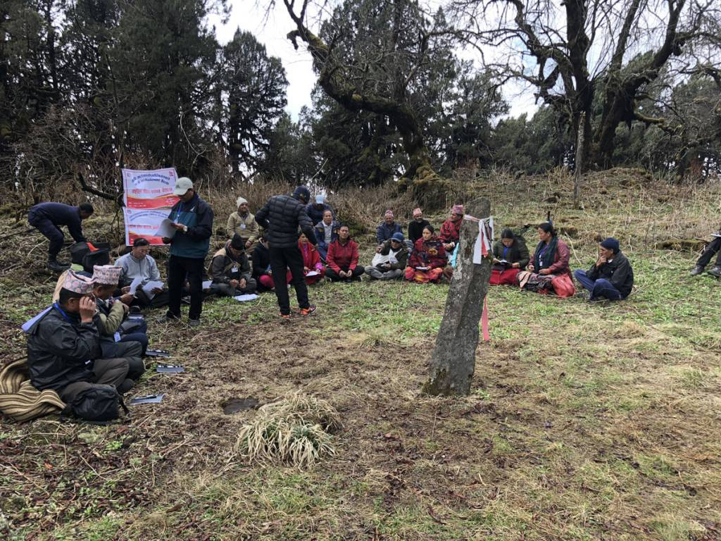 A group of Gurung people doing discussion about how to develop the accester land Gurung heritage trail