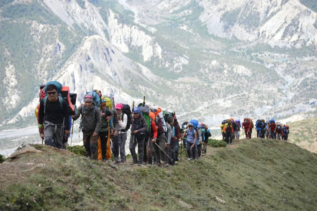 Travelers on the way to Kang-La Pass Trekking to manang