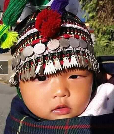 Kham tribal child in traditional head wear called bijouta, culture of Nepal