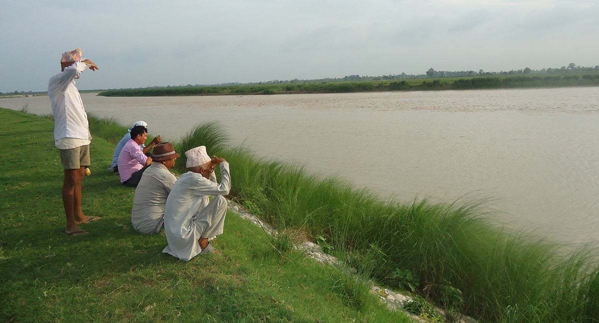 locals watching dolphins in Kailali