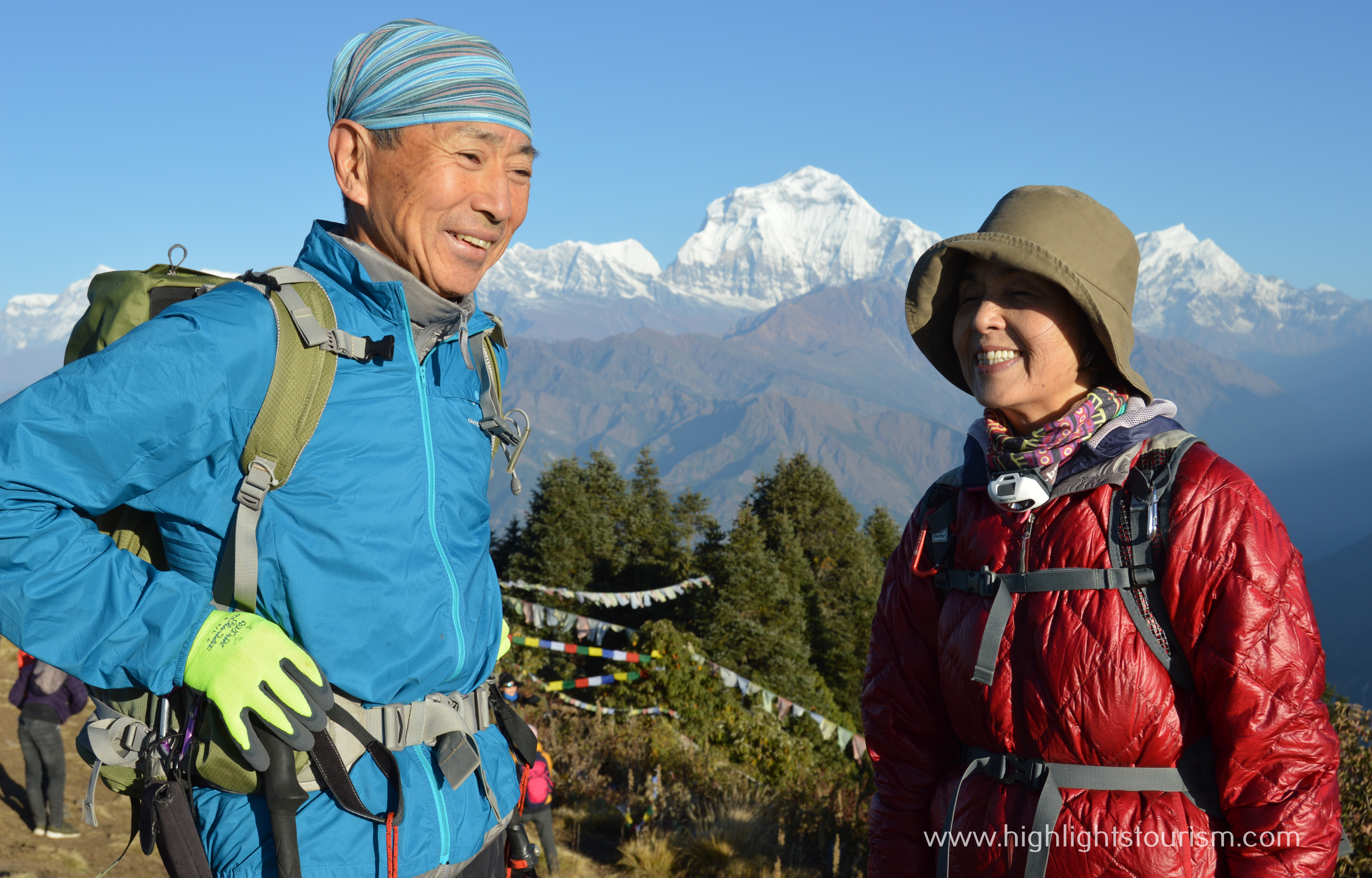 tourist couple standing on Poon hill