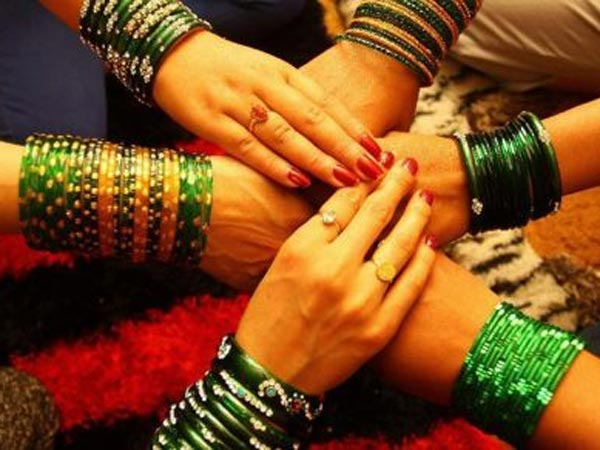 Hands with green bangles