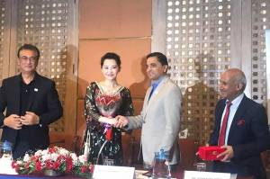 Xu Qing shaking hands with Tourism Minister Yogesh Bhattarai