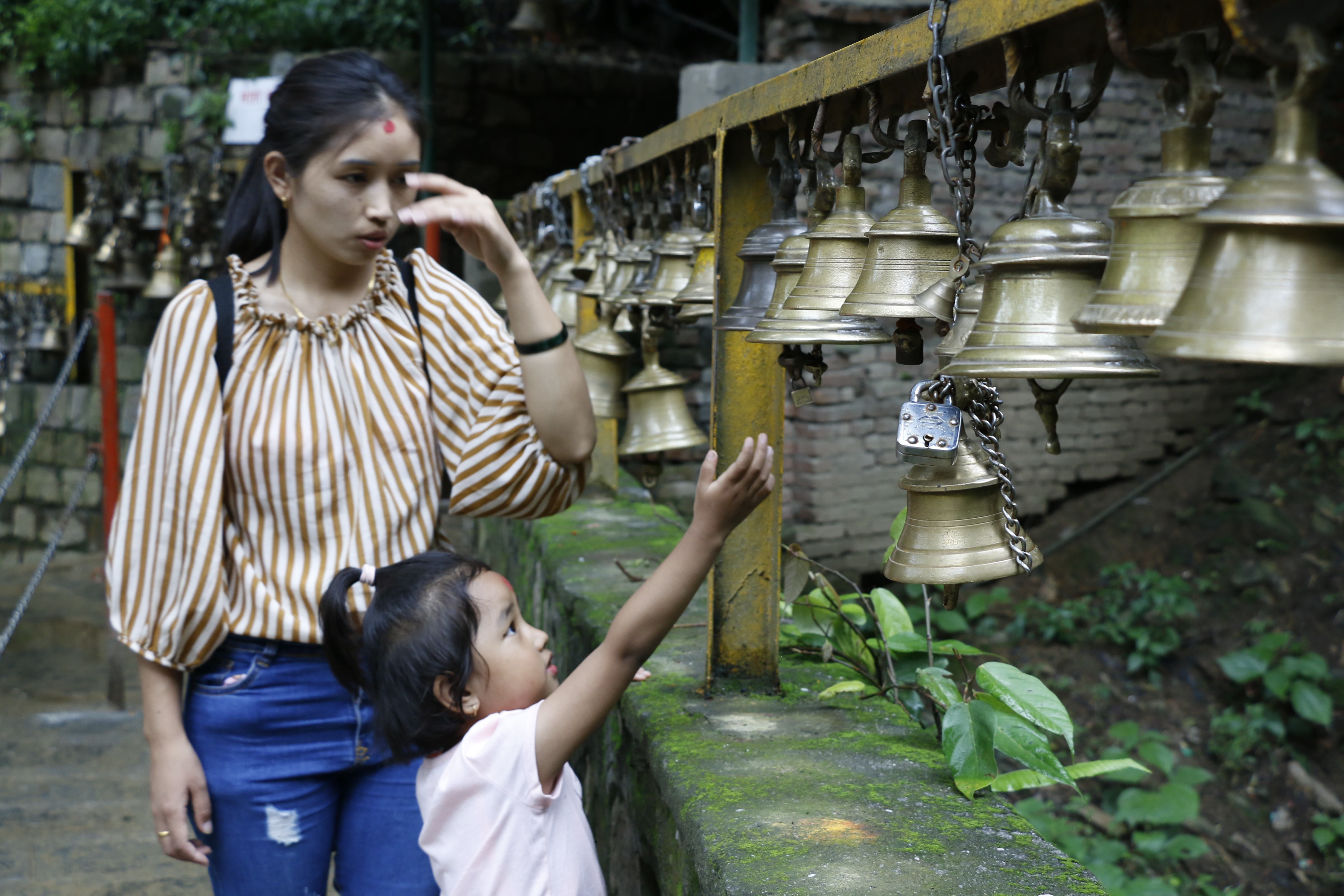 visitors ringing the bell