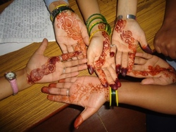 Hands decorated with hena