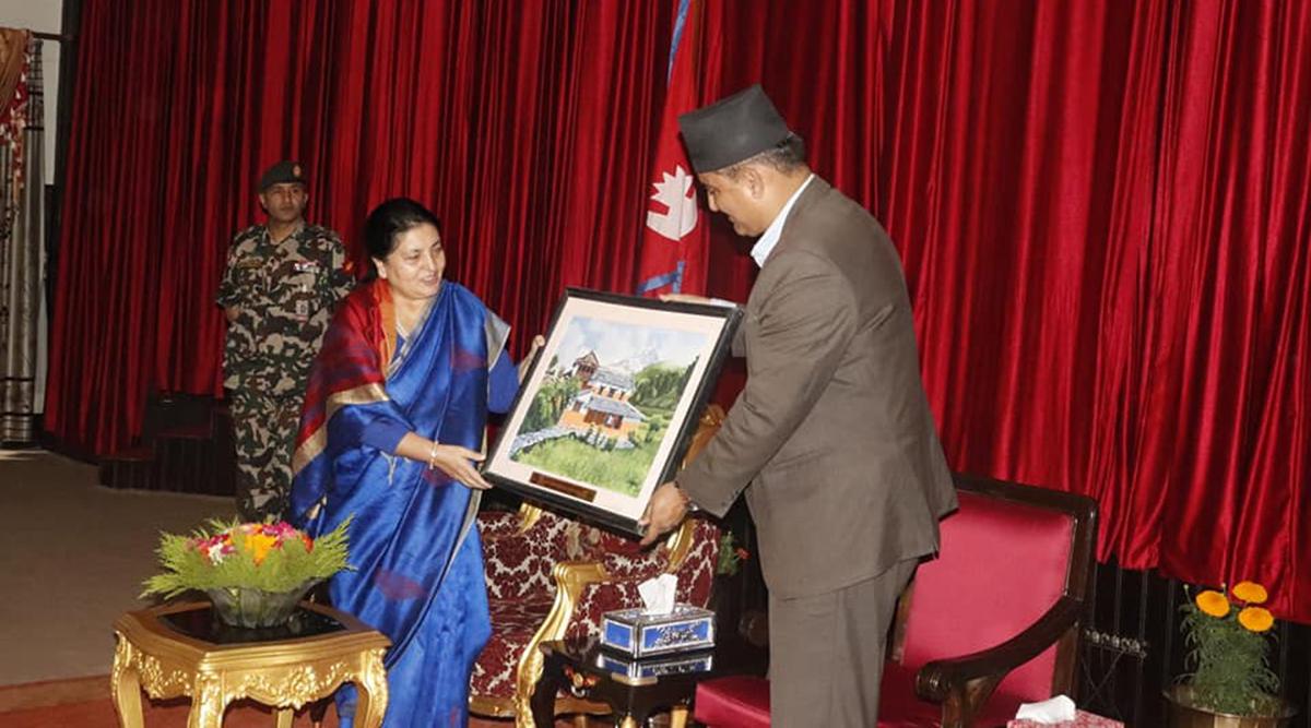 Gandaki Tourism Minister Bikash Lamasal handing tourism token of love to President Bidya Bhandari